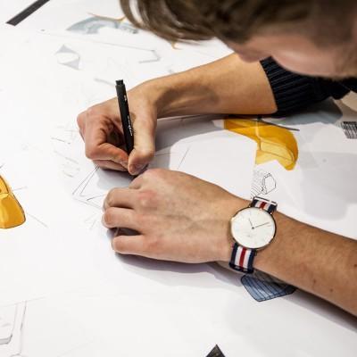 Designer sketching new products, armchairs, for Oot-Oot Studio furniture collection. Disainer visandab uusi tugitooli disaine Oot-Oot Stuudio mööbli kollektsiooni.